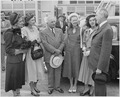 Photograph of President Truman with Secretary of State Dean Acheson and members of his family, at the airport in... - NARA - 200116.tif