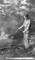 Photograph of Using a Hose from a Jeep Tanker for Fire Suppression - NARA - 2129577.tif