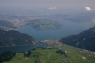 Luzern–Stans–Engelberg railway line - The route of the line towards Luzern, passing through Stansstad and across the bridge over the lake (lower centre) before tunneling under the Lopperberg to Hergiswil (mid left) and Luzern (upper centre).