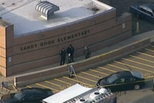 Police are seen at Sandy Hook Elementary School after a school shooting.