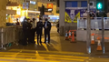 Police standby outside Prince Edward Station Exit 20210228.png