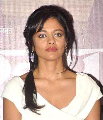 Peruchazhi - Image: Pooja Kumar at Promotions of 'Vishwaroop' with Videocon (01) (cropped)