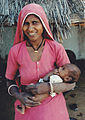 Poor female and her child India.jpg