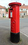 Post box on Cortsway, Greasby 2.jpg