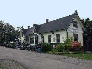 Parc Linéaire Le P'tit Train du Nord - The former train station in Prévost along the trail.