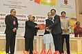 """Pranab Mukherjee presenting the Special Mention Certificate for """"Pride of Tamil Cinema"""" (1931-2013) in the category of Best Writing on Cinema to the Author, Shri G. Dhananjayan, at the 62nd National Film Awards Function.jpg"""