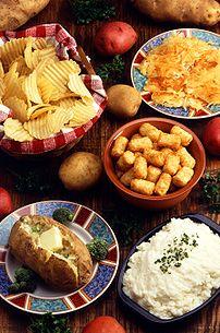 various potato dishes: potato chips, hashbrowns, tater tots, baked potato, and mashed potatoes