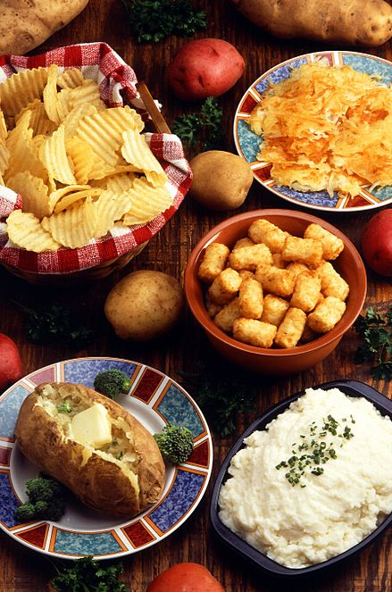 Various potato preparations: (clockwise from top left) potato chips, hashbrowns, tater tots, mashed potato, and a baked potato PreparedPotatoes.jpg