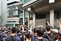 Protesters give Middle finger to the police force in Police Headquarter 20190621.jpg