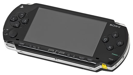 "A PSP-1000: the shoulder buttons are on top, the directional pad on the left with the analog ""nub"" directly below it, the PlayStation face buttons on the right and a row of secondary buttons below the screen. Psp-1000.jpg"