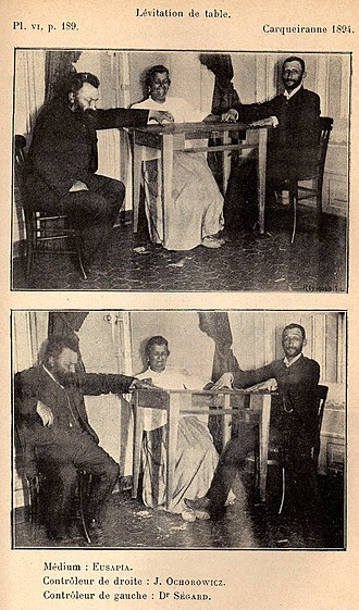 Eusapia Palladino - Palladino, 1894; Julian Ochorowicz (left) controls right hand; Dr. Ségard controls left hand and feet.