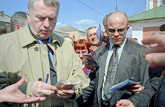 Vladimir Zhirinovsky - Zhirinovsky in 2004 freely handing out money to the public and random passersby, in a famous gesture.