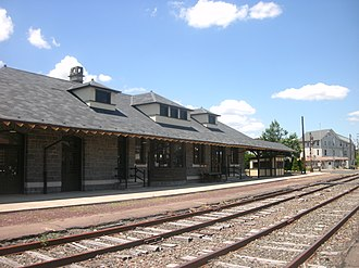 Quakertown station - The former station depot at Quakertown station, as seen from the Allentown-bound platform in June 2012.