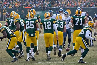 Quarterback - QB Aaron Rodgers (12) and the Green Bay Packers breaking the huddle.