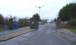 MoD Lyneham - Station entrance with the de Havilland Comet gate guardian