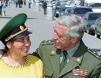 Border Guards Day - A border guard veteran and his wife embrace during the celebrations in 2004.
