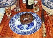 A haggis on a Rabbie Burns plate.