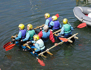 Children successfully test their raft, in Brix...