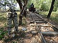 Rails, Locomotive, and Mutilated Sculpture - Burma-Siam 'Death Railway' - Thanbyuzayat - Near Mawlamyine (Moulmein) - Myanmar (Burma) (11955238196).jpg