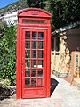 Red phone box - Gibraltar Botanic Gardens.jpg