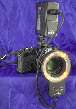Ring flash - Samigon ring flash unit attached to lens of single-lens reflex camera