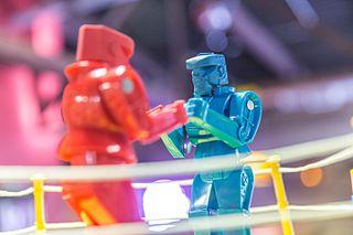 <i>Rock Em Sock Em Robots</i> Two-player action toy and game