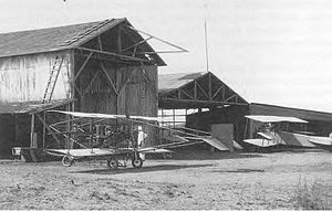 United States Army World War I Flight Training - Hangars at the North Island, San Diego, California airfield in 1912. Aircraft shown is a Curtiss Model E (Left) and Curtiss Model G (Right). Later known as Rockwell Field.