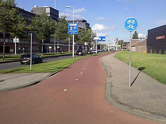 Cycling in the Netherlands - A typical Dutch bike path, Rotterdam.