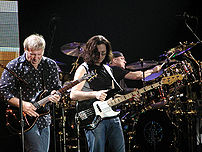 Peart (right) performing with Rush.