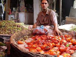 Sadr City - A local merchant operates a stall in the city's market