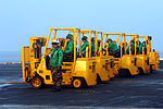 Sailors wait in their forklifts for incoming cargo on the flight deck of the aircraft carrier USS John C. Stennis (CVN 74) during a replenishment at sea on March 30, 2013 130330-N-QI595-008.jpg