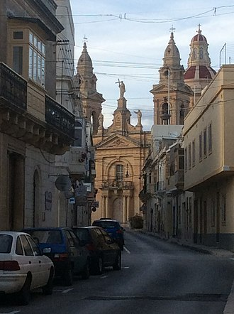 St Andrew's Parish Church, Luqa - St. Andrew's Church as seen from far in Luqa streets