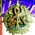 Saint Henry Catholic Church (St. Henry, Ohio) - artifact, pelican medallion from the old altar.jpg
