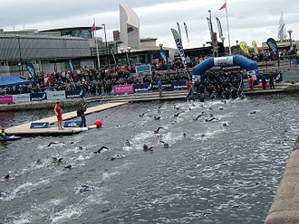 Open water swimming - And walk into the water:the start of the one mile course.