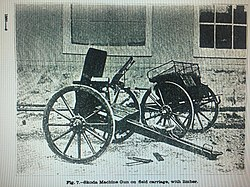 Salvator Dormus 1893 (commonly called Skoda 1893) Machine Gun on landing carriage with brass water jacket and ammunition boxes and limber. Not also chargers for the magazine on the ground. Photo in Text 1901.jpg