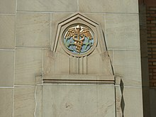 An anchor and caduceus  on the exterior of a building