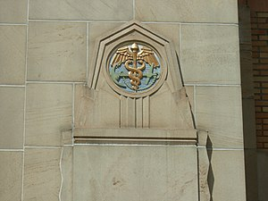 Pacific Tower (Seattle) - An anchor and caduceus from the building's use as a Marine facility