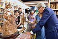Secretary Kerry examines wood carving at Cottage Emporium in New Delhi.jpg