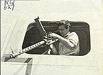 Sergeant Ryan 24 Squadron RAAF with waist gun Fenton NT 1944 AWM NWA0627.jpg