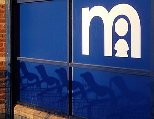 Mothercare - Shadows of child seats on shopping trolleys cast their shadows on the front of the Mothercare at Wren Park, Torquay