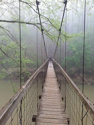 Sheltowee Trace Trail - Hiker crossing the Red River