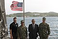 Ship's master and military detachment members of USNS Carson City (T-EPF-7) with South Aegean Governor standing in front of American flag during tour of ship US Navy 180319-N-NO901-002.jpg