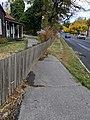 Sidewalk veering off through fence and into yard.jpg