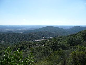 Sierra de Aracena - Landscape of Sierra de Aracena with the ubiquitous small village in the valley
