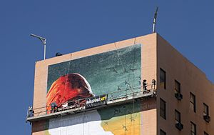 Sign painting - Sign painters create a new sign on the walls of the Figueroa Hotel in Los Angeles, California