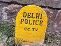 Signage of a stone near CCTV camera post, Delhi.jpg