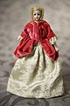 Simon and Halbig Bisque Doll Wearing Fuschia Velvet Jacket with White and Silver Skirt.jpg