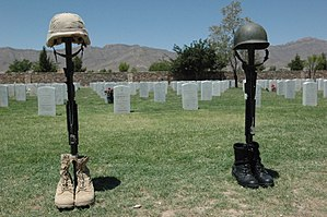 Fort Bliss National Cemetery - Traditional rifle, helmet, and boots memorial honor at Fort Bliss National Cemetery