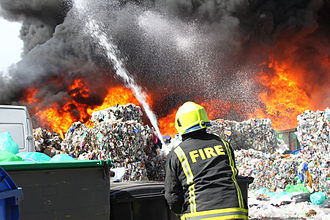 South Yorkshire Fire and Rescue - South Yorkshire Fire and Rescue officer fighting a fire at a reclamation yard in July 2013