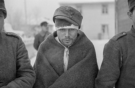 Soviet prisoners of war dressed with new clothes near the Arctic Circle at Rovaniemi in January 1940 Soviet POWs.jpg